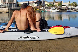 Couple-sitting-on-Tandem-Kayak-X-Caliber-Malibu-Kayaks | by malibukayaksinc