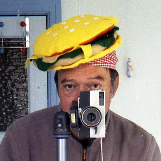 reflected self-portrait with Ricoh Auto 35 camera and burger hat