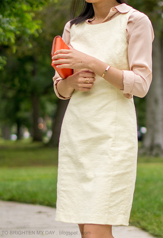 peach silk shirt, pale yellow dress, orange clutch