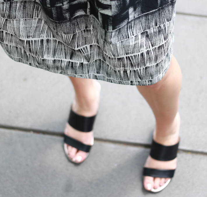 professional outfit: business casual in abstract printed skirt and mules