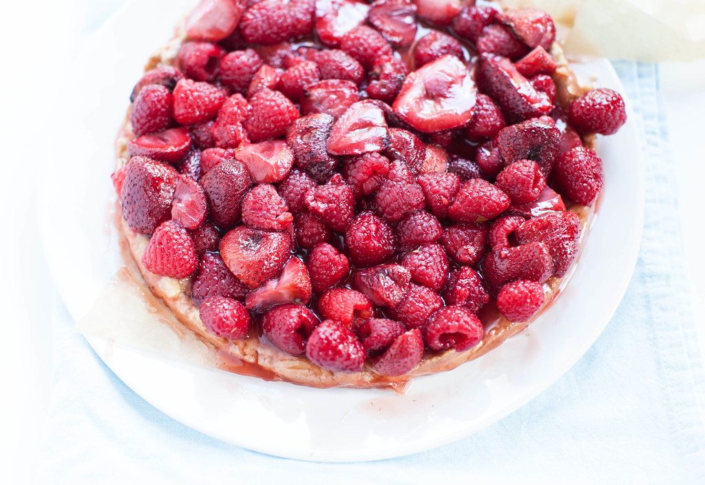 roasted strawberry raspberry tart with toasted almond crust