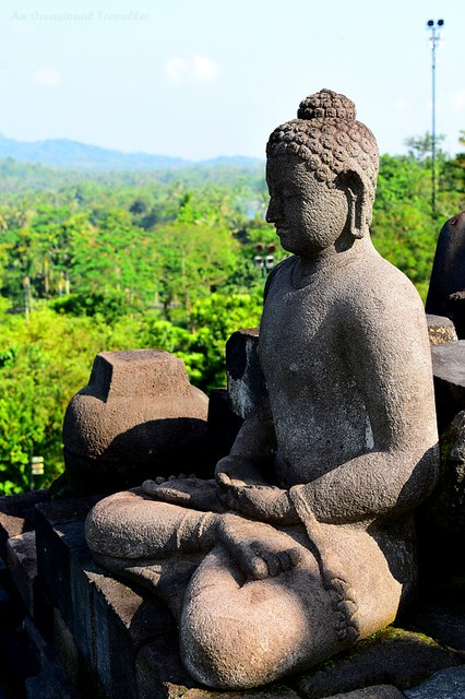 One of the 500+ Buddha statues at Borobudur Temple