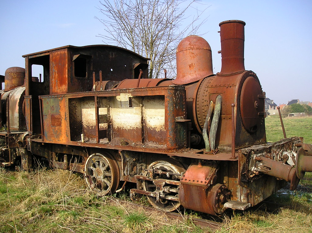 Old Small Rusty Steam Locomotive. This