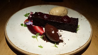 Warm Chocolate Brownie, Salted Coconut Ice Cream, Cherry Gel, Hazelnut Ganache at Transformer
