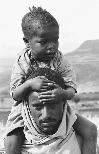 A child sits on his father's shoulders as they wait for food at a drought relief centre in the north-eastern town of Bati.