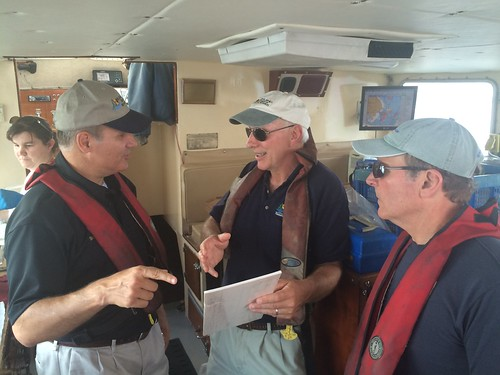 Photo of Secretary Mark Belton with the crew on board the department's Research Vessel Kehrin
