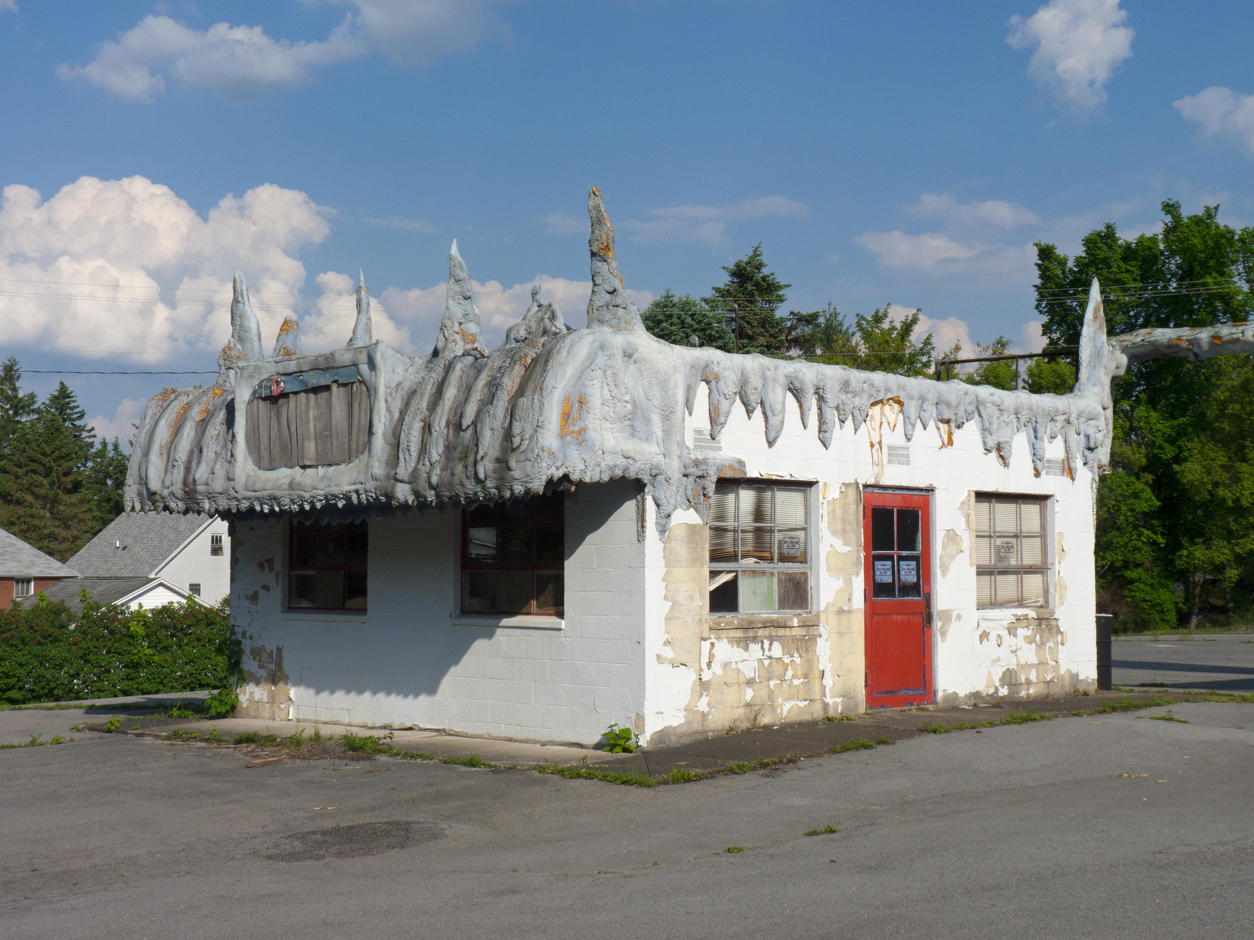 Abandoned ice cream stand situated next to shuttered Holgate Toy Company complex - Kane, Pennsylvania U.S.A. - June 1, 2016