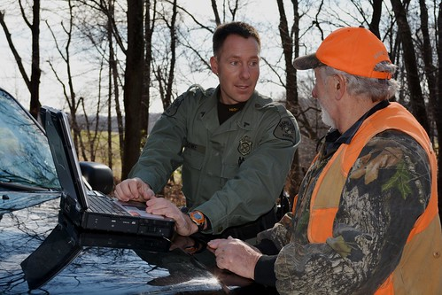 Photo of hunter talking with conservation officer