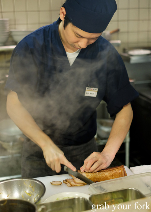 Slicing the roast pork made in-house at Bannai Shokudo, Kyoto Ramen Street inside Kyoto station, Japan