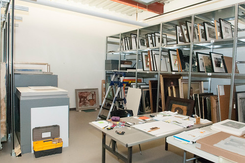 The collections storage areas have racks and shelving units to house artwork.