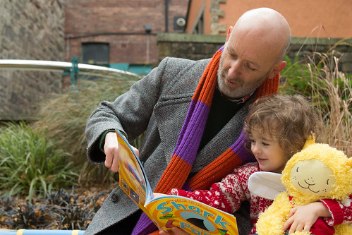 Nick Sharratt and Aoife (3) read Shark in the Park on a Windy day