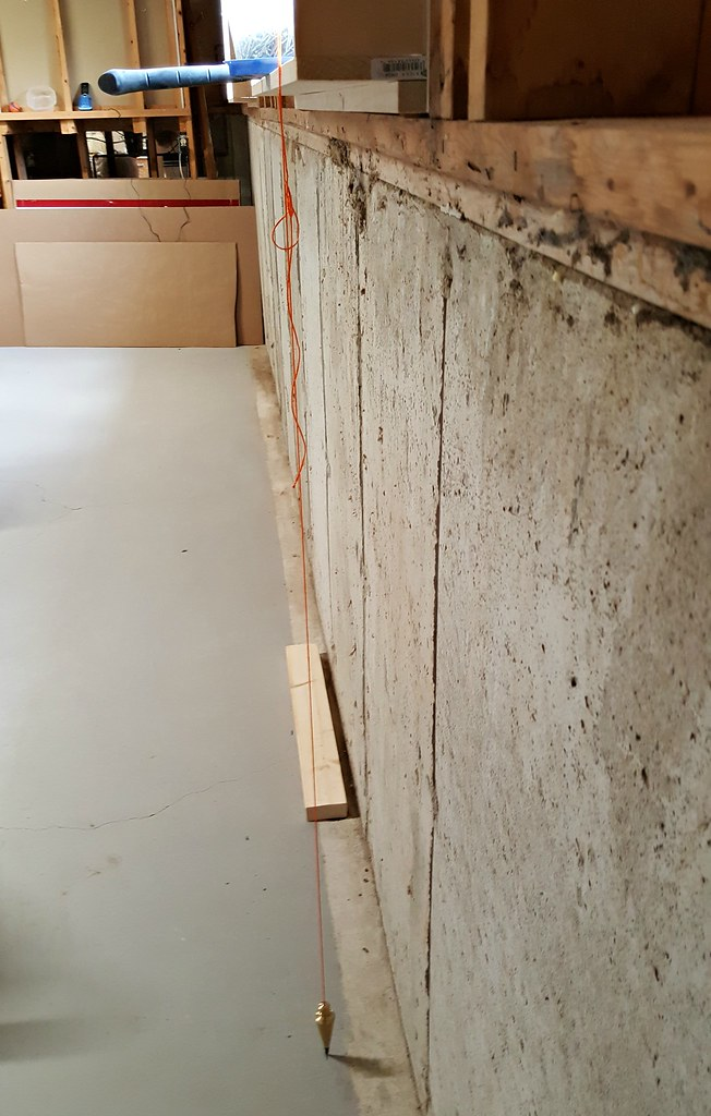 basement framing and spray foam insulation plumb line