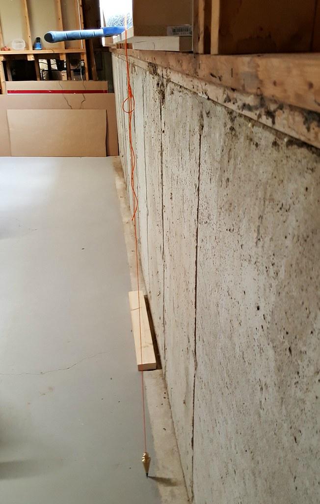basement framing and spray foam insulation plumb line
