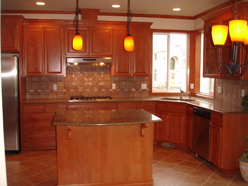 Orange Kitchen Walls With Brown Cabinets