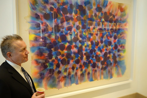 "Mark Myers stands in front of Ken Young's ""Spring Rain."" From Artworks from the Wonderful to the Whimsical: The Heritage Collection at MGM National Harbor"