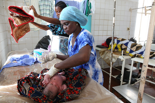 Nurse cleans a newborn child | by World Bank Photo Collection
