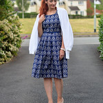 Navy floral vintage-style fit-and-flare dress, white cardigan