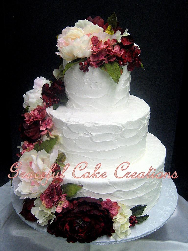 Wedding Cake With Burgundy And Blush Flowers