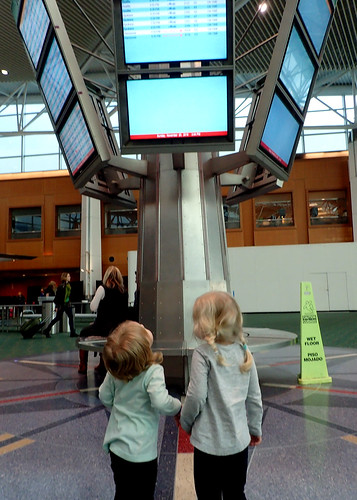 My sweet twins at the airport, looking absolutely nothing alike.