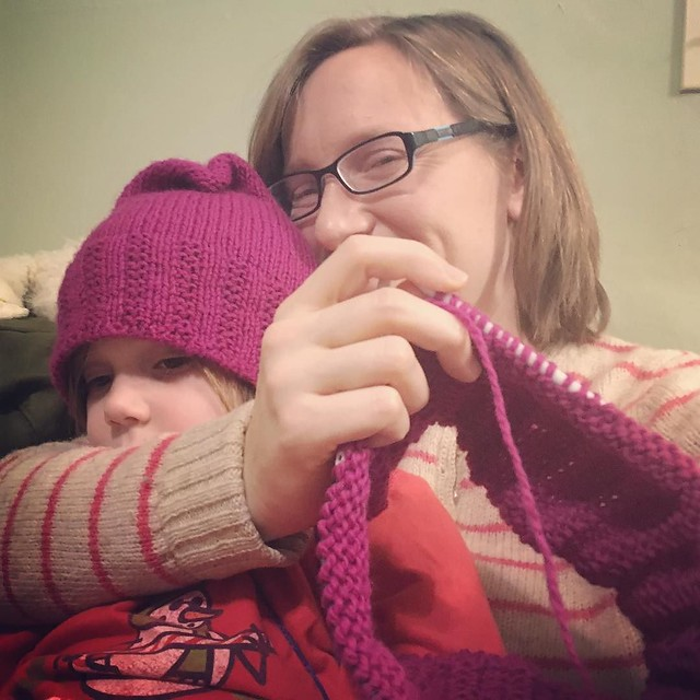 "Knitting pussyhat number two with the very needy wearer of pussyhat number one in my lap. It's been a very ""need to be touching mama"" sort of day here."