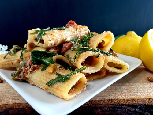 creamy sun-dried tomato rigatoni with arugula
