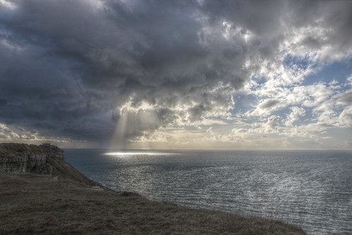 Portland Island - dramatic clouds and sun breaking through