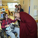 The Dalai Lama with a patient at the NIH