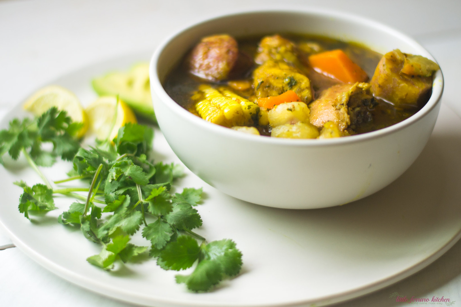Dominican Sancocho Recipe is a hearty three meat stew filled with robust flavors of sazon, adobo and packed with hearty bites of yucca, plantain and corn.