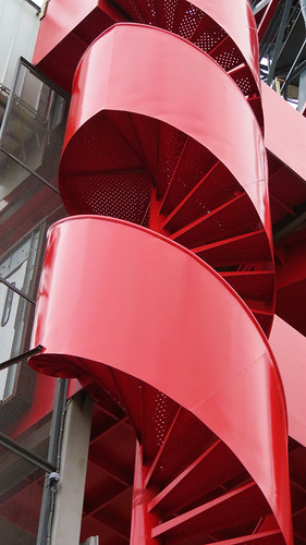 A bright red spiral staircase in NDSM, an industrial area across the river from Amsterdam
