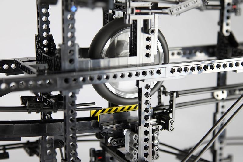 Complicated LEGO Machine Continually Accelerates Small Balls Through ...