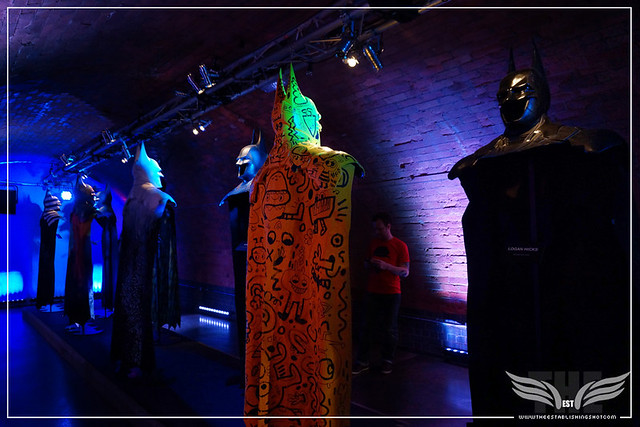 The Establishing Shot: BATMAN: ARKHAM KNIGHT CAPE & COWL EXHIBITION - R-L GOTHIC GOTHAM BY LOGAN HICKS & YELLOW BAT CAPE CLUB BY JON BURGERMAN - KACHETTE, LONDON