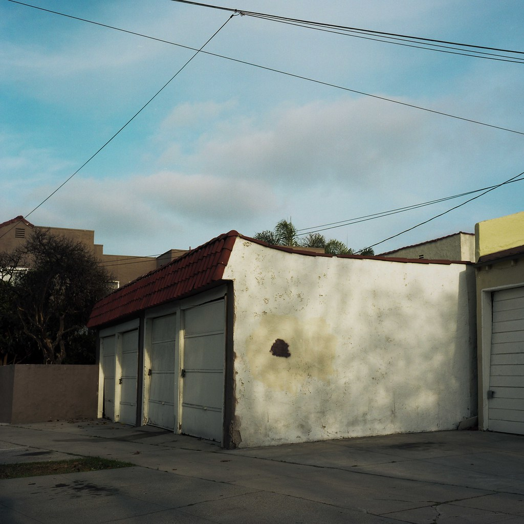 Mottled garage, wires, sky | by ADMurr
