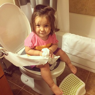Just like big sis. (Except her diaper is still 100% snapped and she uses 10x the amount of toilet paper.)
