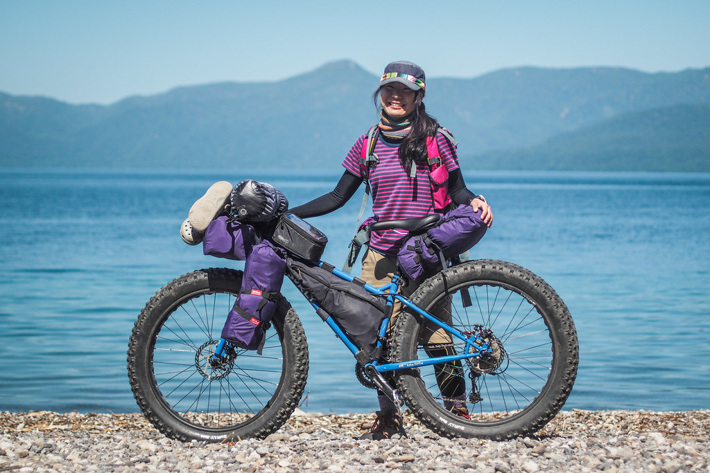 Kumiko and her awesome XS sized Surly Pugsley with self-made custom bike packs (Lake Shikotsu, Hokkaido, Japan)