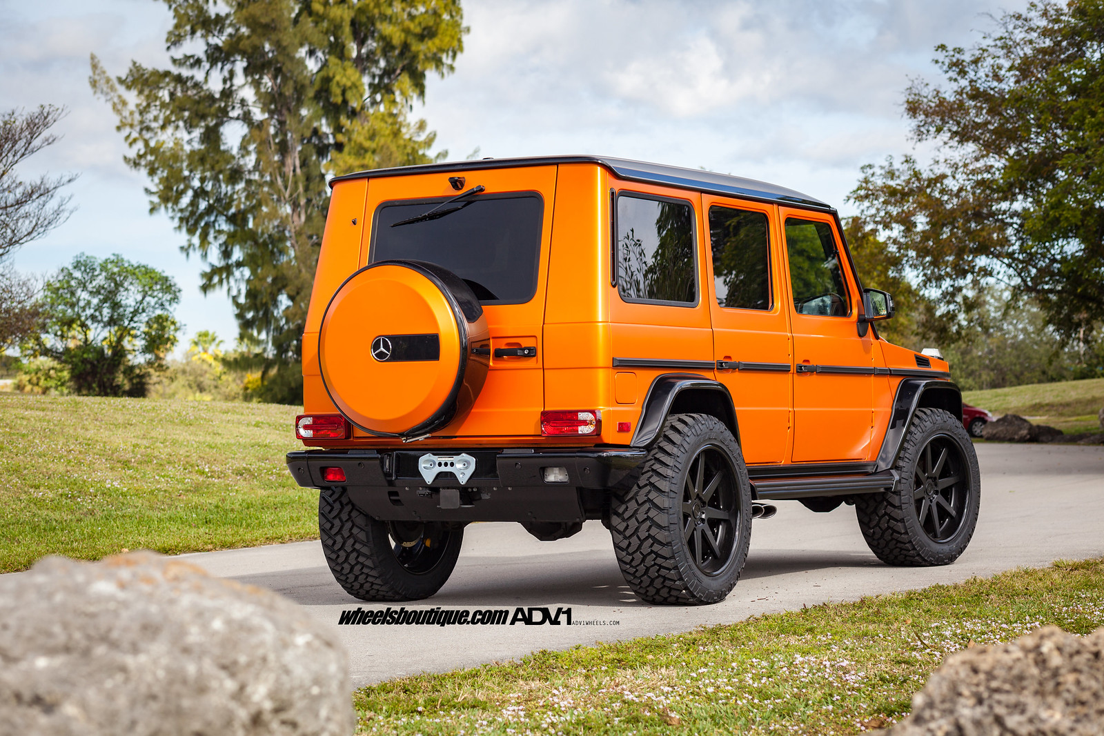 Orange is the new black dual lifted g wagons by wheels for Mercedes benz orange