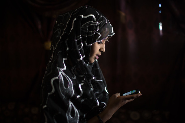 Ubah Jemal, 15, makes a call before a meeting of the Girls Club in Jigjiga, Somali Region, Ethiopia