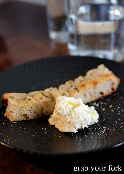 Housemade ricotta with focaccia at Tipo 00 pasta bar in Melbourne