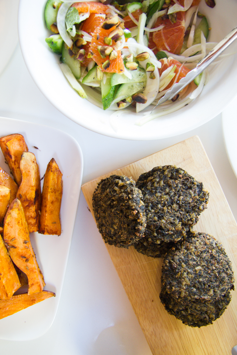 baked kale + mushroom burgers, cumin sweet potato and fennel, orange + cucumber salad