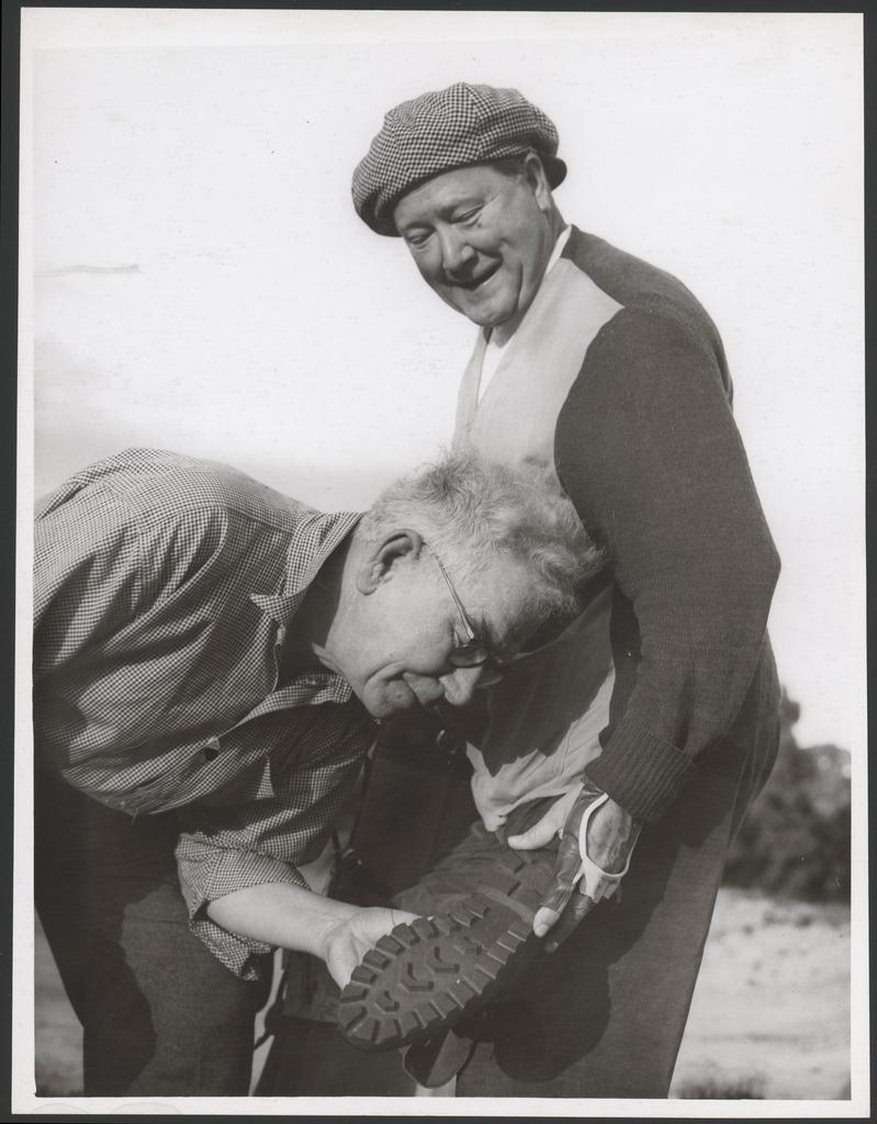 John Charles Thomas shows his American golf shoes to Mr Ge…
