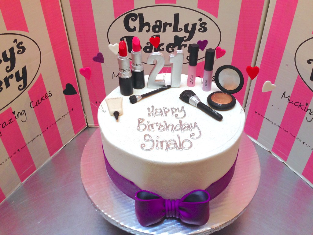 Single Tier MAC Make Up Themed 21st Birthday Cake Iced In White Butter Icing With 3D Lipsticks Lipgloss Bronzer Concealer Tube Brushes