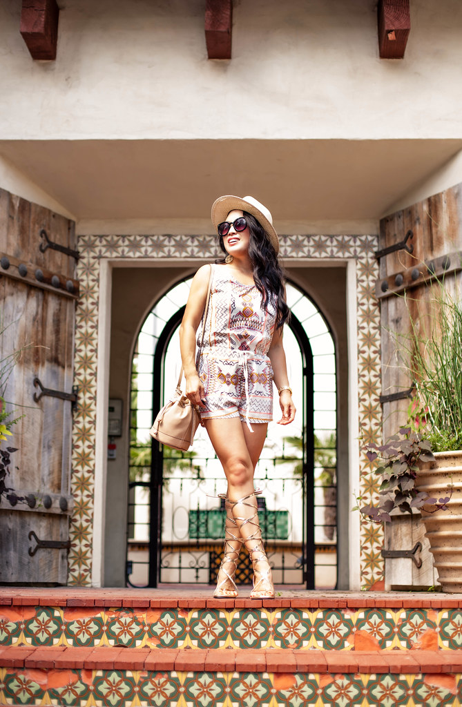cute & little blog | petite fashion | on trend tuesdays linkup | tribal romper, gold strappy gladiator sandals, bucket bag, panama hat | summer outfit