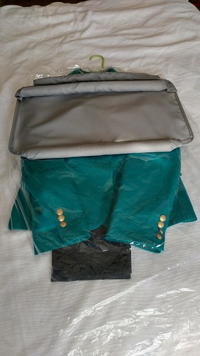 2 Packing a Suit: Place insert on top, with padded edge in middle