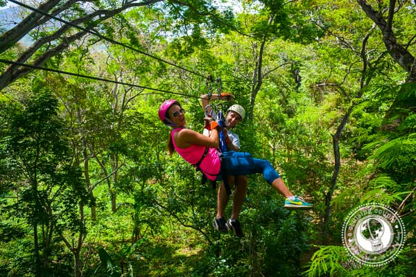 A Cruising Couple Ziplining in the Mombacho Volcano Reserve Granada Nicaragua