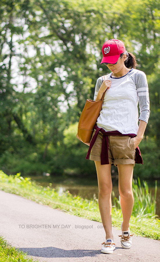 red cap, baseball tee, cargo shorts, canvas boat shoes