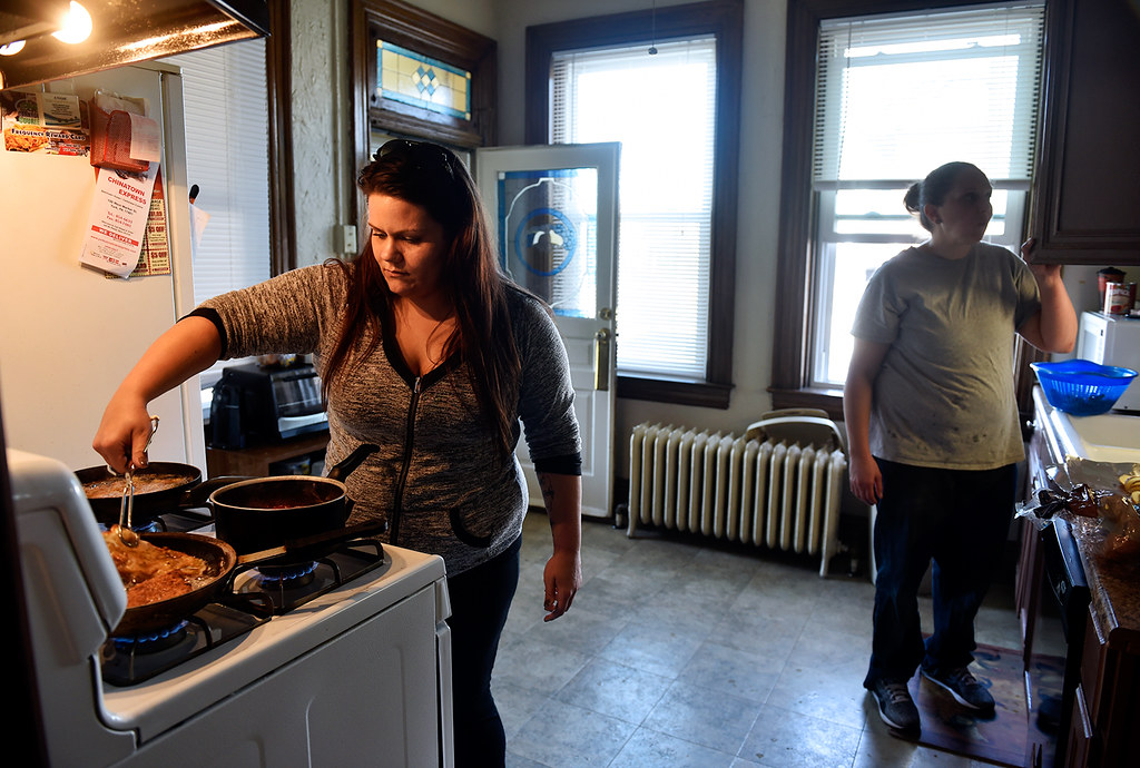 © 2016 by The York Daily Record/Sunday News. Christina Whelan, 27, of New Jersey, makes chicken parmesan with help from Allison Foust, 36, of Havre de Grace, Md., at the Pennsylvania Avenue house where they live and which is operated by Choices Recovery House, on Monday, March 7, 2016. Similarly to many other York recovery houses, residents at Choices are largely responsible for their own meals except for several weekly communal dinners.