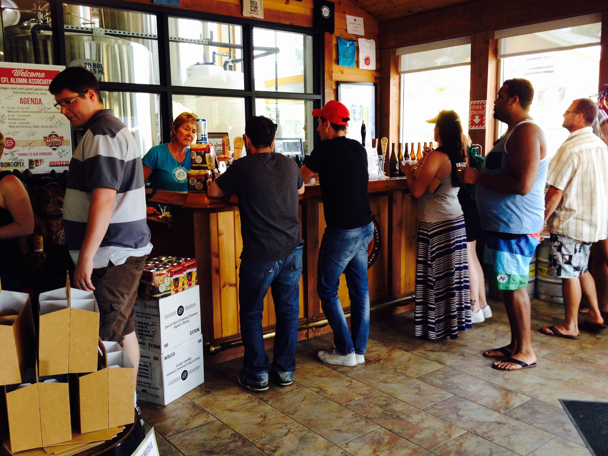 Customers looking for some samples at our bar in the retail space.