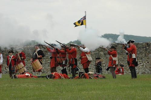 Historic Reenactors Dressed as Troops Demonstrate Firing Weapons