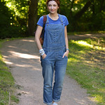 Blue t-shirt, denim dungarees (overalls), tennis shoes