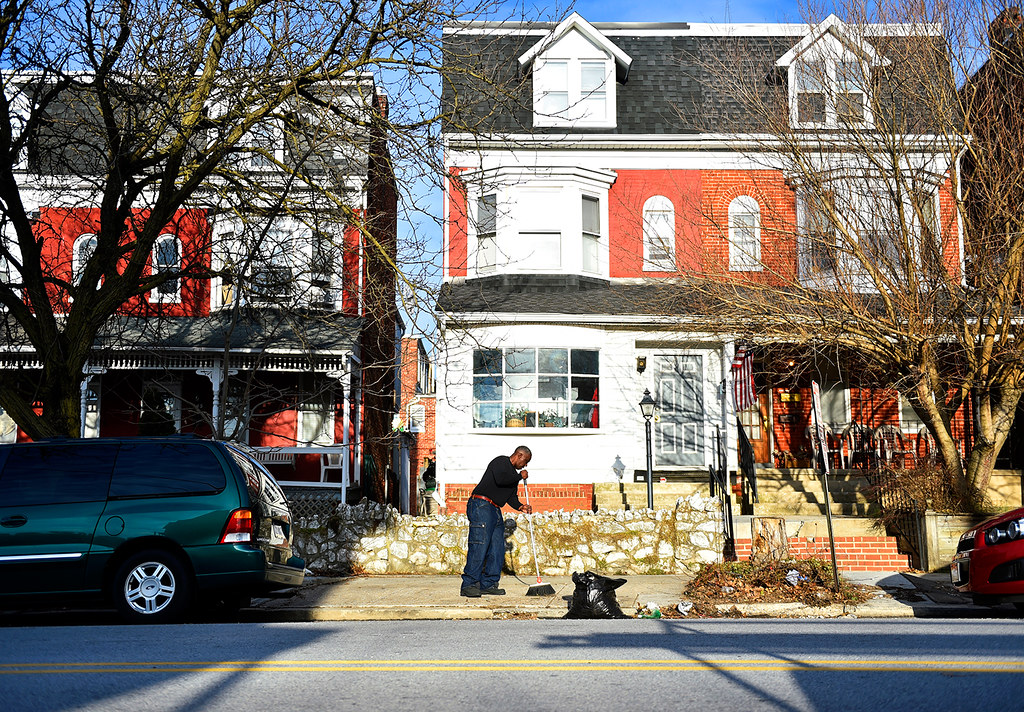 © 2016 by The York Daily Record/Sunday News. Anthony McClair, 50, originally of Bronx, N.Y., sweeps the sidewalk outside the Linden Avenue recovery house where he lives and which is operated by Sees-the-Day, on Sunday, Feb. 28, 2016. The house, of which McClair is the resident president, is home to 11 men ranging in age from 19 to 54.
