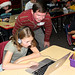 David Kratzer, of the Los Alamos National Laboratory, works with students during the 2016 Hour of Code, which aims to encourage children to learn computer science. More than 60 Lab employees volunteered at 16 schools, working with nearly 2,000 students.